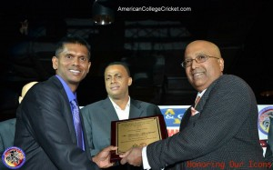 Shiv Chanderpaul being inducted into the American College Cricket Hall of Fame, by Lloyd Jodah. Fast bowling great Courtney Walsh is center.