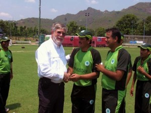 Chuck Bennett with cricket players. Photo by Laiq Ahmed