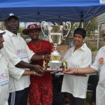 USACUA's Fitzroy Hayles recieving the Trophy from the wife & son of Jerry Kishun. Krish Prasad on right.