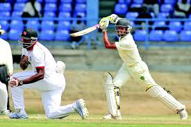 Tage Brandon Chanderpaul drives, playing for Guyana (senior team).Kieron Pollard is the fielder.