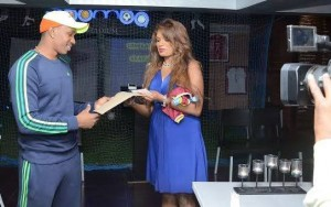 Dwayne Bravo receiving his Contract from his agent Emma Everett.
