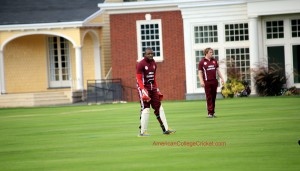 Norris Guscott (Harvard) behind the stumps