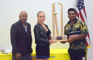 U of South Florida Bulls Captain Sai Ramesh receiving the Championship Trophy from Anja, with Lloyd Jodah American College Cricket Founder & President.