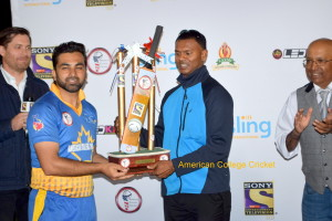 Shiv Chanderpaul presenting the Chanderpaul Trophy to Hassan Mirza, Captain of Ryerson Rams as Lloyd & Jamie Paul look on.